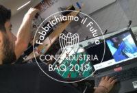Mail dei ragazzi che lavorano al calcio balilla e il logo sovrapposto del BAQ 2019
